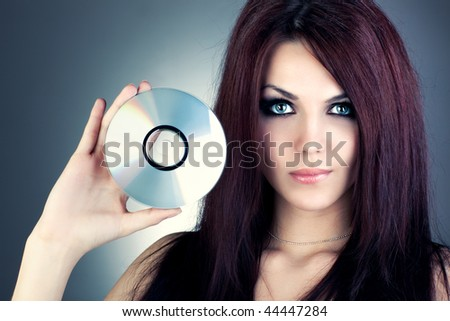 Young fashion woman with CD portrait. - stock photo
