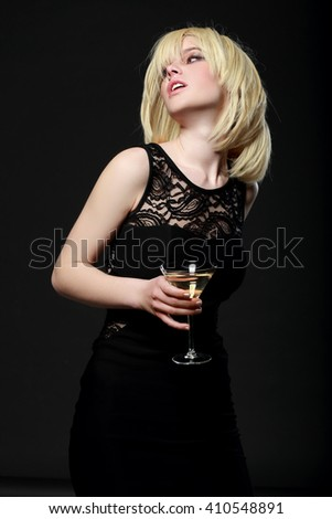 young fashion woman with glass of martini - stock photo