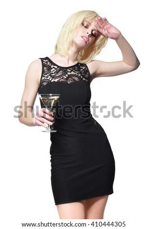young fashion woman with glass of martini, profile, studio shot - stock photo