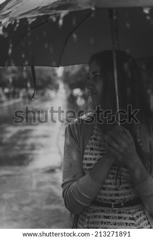 Young fashion woman with umbrella in autumn foggy morning - stock photo