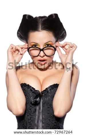 Young fashionable female holding her eyeglasses sides isolated on white - stock photo