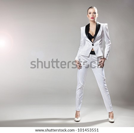 Young fashionable lady posing - stock photo