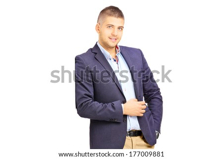 Young fashionable man leaning against a wall isolated on white background
