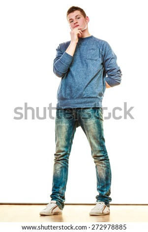 Young fashionable man teen boy in full length casual style blue jeans thoughtful expression isolated on white - stock photo