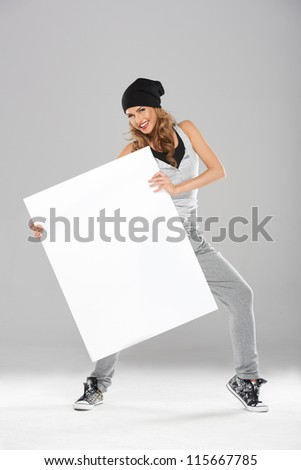 Young fashionable modern dancer holding white empty board - stock photo
