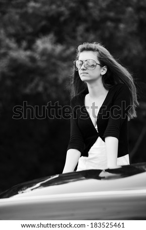 Young fashionable woman at the classic car - stock photo