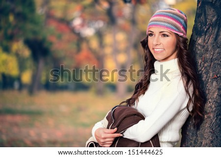 Young fashionable woman in autumn forest