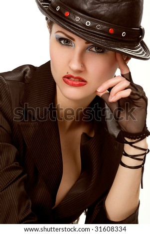 Young fashionable woman with black hat