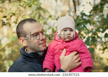 Young father and baby girl have fun in autumn, park - stock photo