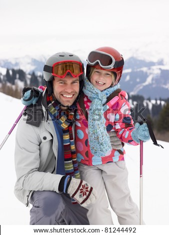 Young Father And Daughter On Ski Vacation - stock photo
