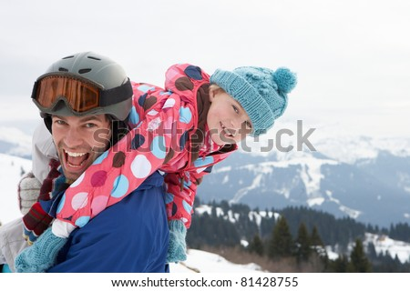 Young Father And Daughter On Winter Vacation - stock photo
