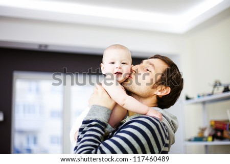 Young father and his baby - stock photo
