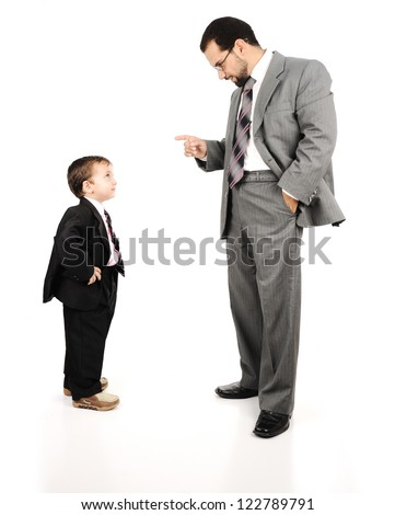 Young father and his son wearing suits