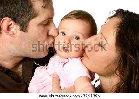 Young father and mother giving passionate kiss to beautiful baby girl, isolated on white. - stock photo