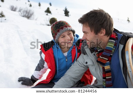 Young Father And Son In Snowy Landscape - stock photo