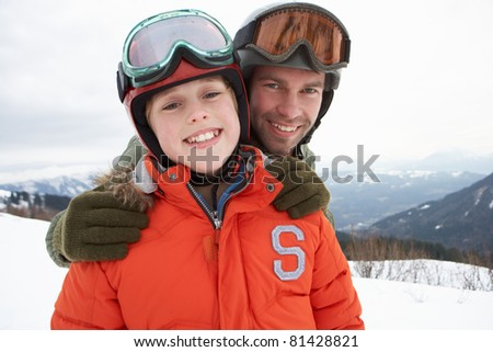 Young Father And Son On Winter Vacation
