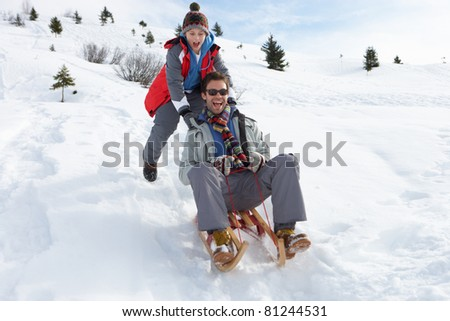 Young Father And Son Sledding - stock photo