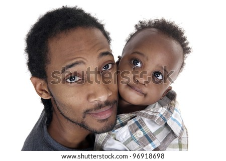 young father and toddler son portrait on white background