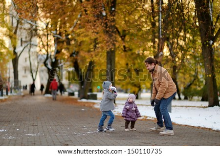 Young father and two kids having fun on winter day - stock photo