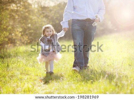 Young father during morning walk with his little daughter - stock photo