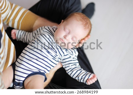 Young father holding his sweet little newborn baby  - stock photo