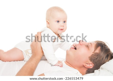 Young father is having fun with his little baby over white background