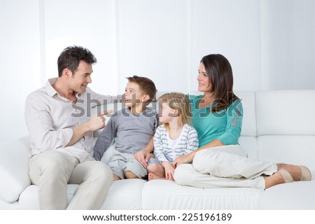 young father joking with his little child - stock photo