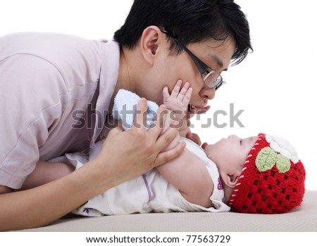 young father playing with his 4 months old baby girl - stock photo