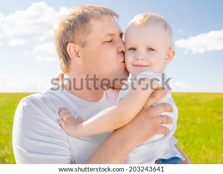 young father with her daughter outdoor on a summer day - stock photo