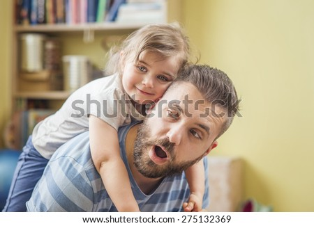 Young father with his cute little daughter - stock photo