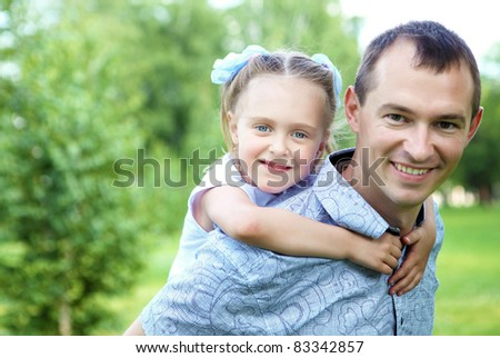 Young father with his daughter having fun together in summer park