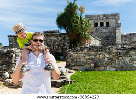 Young father with his son sightseeing in Tulum, Mexico - stock photo