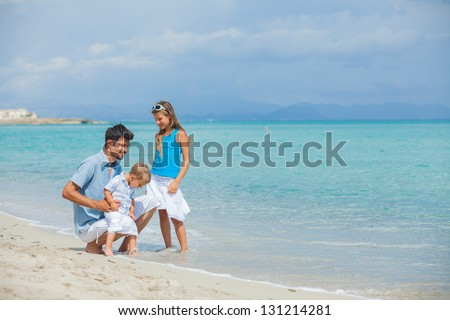 Young father with his two kids on tropical beach vacation - stock photo