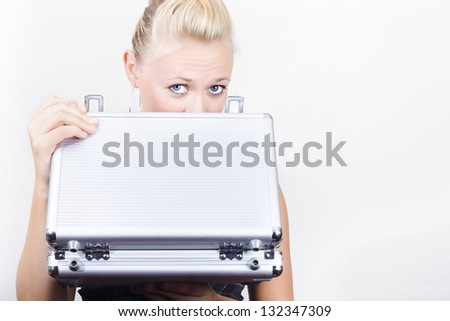 Young female accounts employee looking into a open briefcase in a financial bonus concept