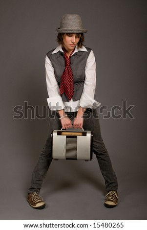 Young female alternative hipster holding retro radio - stock photo