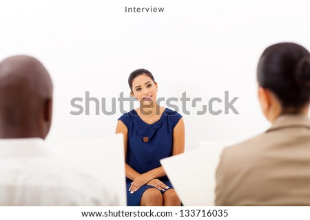 young female applicant during job interview - stock photo