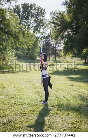 Young Female Archer Training At The Range - stock photo