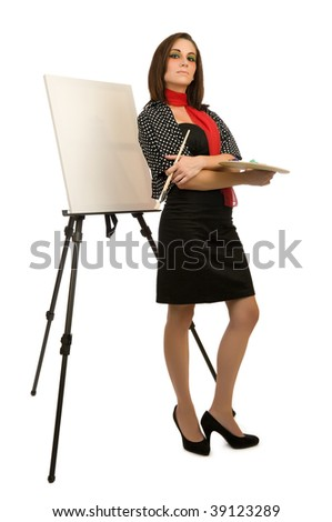 Young female artist posing next to a blank canvas - stock photo