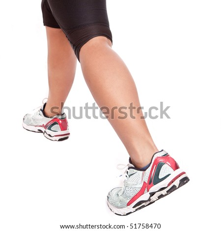 Young female athlete doing her stretching exercise - stock photo