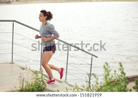 Young female athlete doing running as training and workout - stock photo