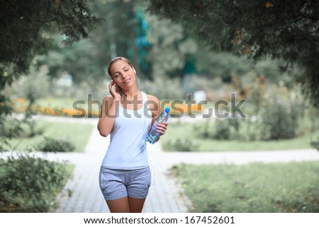 Young female athlete in park - stock photo