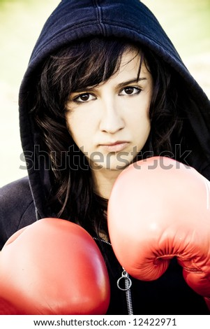 Young female boxer with red gloves - stock photo