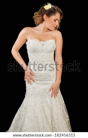 young female bride in wedding dress with black background