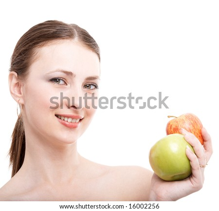 Young female brunette with two apples on white