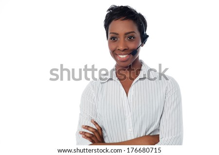 Young female call centre executive posing with confidence