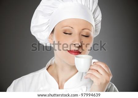 Young female chef enjoying on the coffee break - stock photo