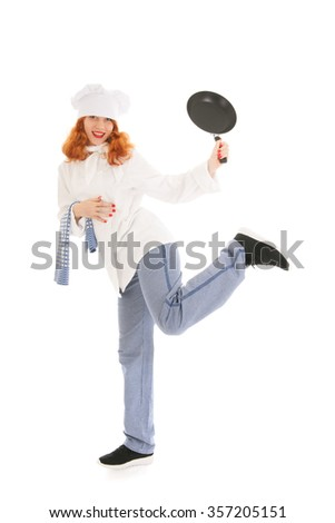 Young female chef having fun with frying pan