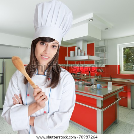 Young female chef holding a wooden spoon in a beautiful kitchen - stock photo