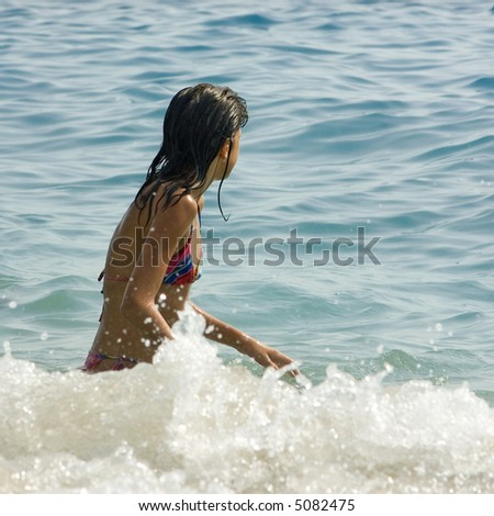 Young female child swimming on the sea - stock photo