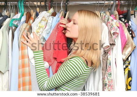 young female choosing clothes - stock photo